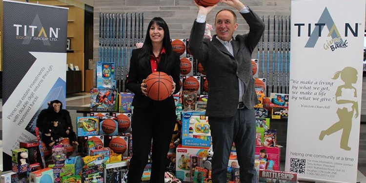 Terry Kotton and Vaughan Mayor Maurizio Bevilacqua get set to shoot basketballs donated by TITAN to the 2013 City of Vaughan's Annual Toy Drive