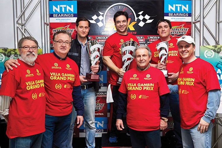 fellow-participants-pose-with-grand-prix-winnersandrew-axe-bordin-2nd-placepeter-koliviras-1st-place-and-andrew-pellerito-3rd-place