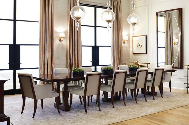 grand spaces such as this elegant dining room complement the innovative layouts