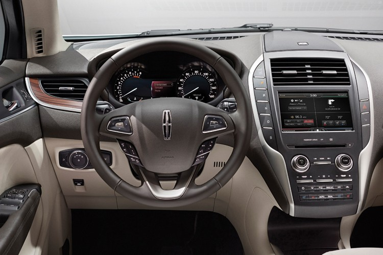 2015 Lincoln MKC: Featuring an architecturally unique instrument panel that showcases Lincoln's signature push-button gear shifter, the Lincoln MKC small premium utility creates an open, welcoming interior,2015 Lincoln MKC: Featuring an architecturally unique instrument panel that showcases Lincoln's signature push-button gear shifter, the Lincoln MKC small premium utility creates an open, welcoming interior