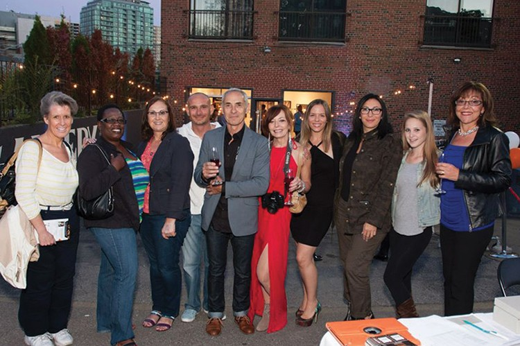 Guests mingle on the patio of the Goodfellas Gallery