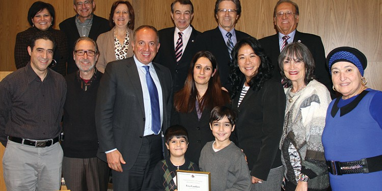 Mayor Maurizio Bevilacqua and members of council with Ward 4 Civic Hero Award recipient Lisa Cantkier and family