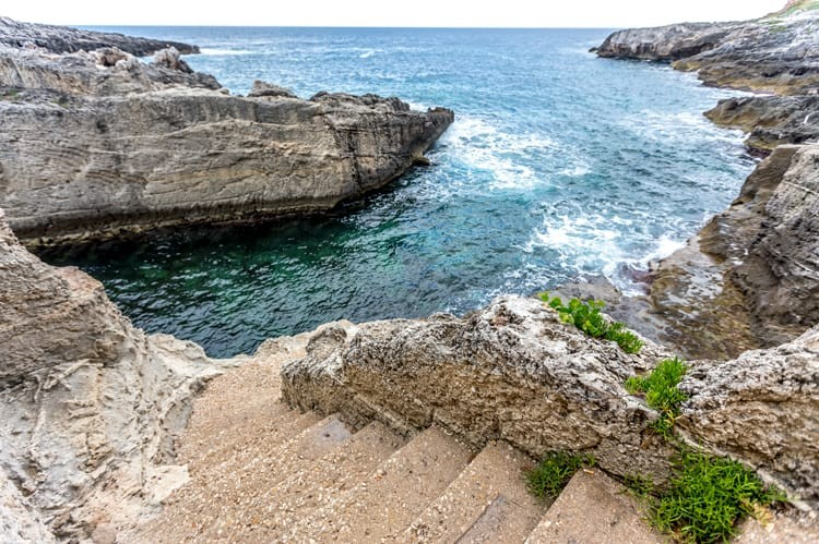 The sea crashes up against the rocks for an atmosphere like no other at Marina di Novaglie's Ristorante Lo Scalo