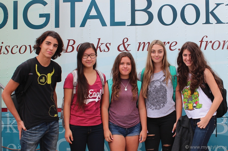 Students from Emily Carr Secondary School in Vaughan enjoy their visit to the Digital Bookmobile outside the Pierre Berton  Resource Library