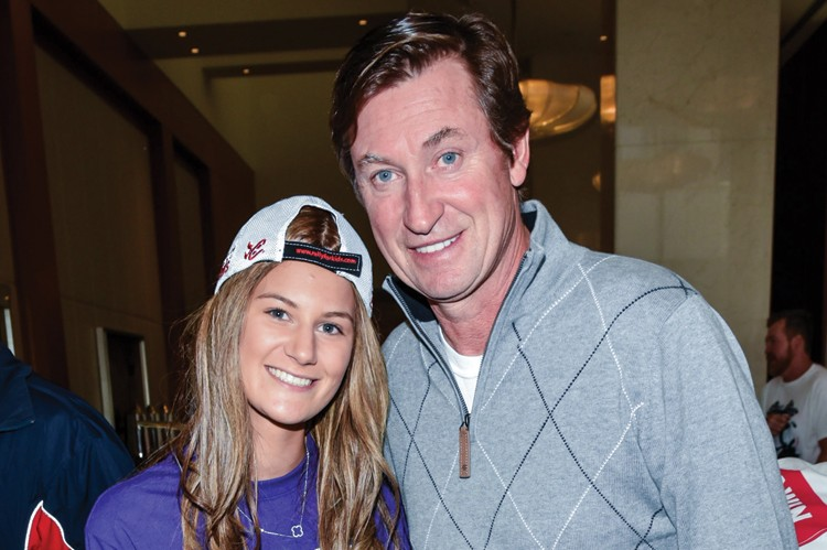 Eloise McIntosh, the second- time No. 1 fundraiser for Rally for Kids with Cancer, poses with hockey legend Wayne Gretzky