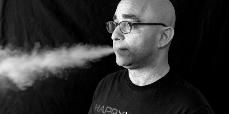 The owner of Happy Vaper takes a drag of his e-cigarette