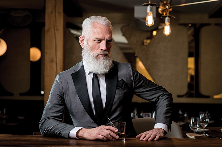 Paul Mason commands the dining room of the newly renovated XXI Chophouse in Kleinburg. He wears a custom-made grey tuxedo by Biella Collection. Clothing and tie provided by Per Lui
