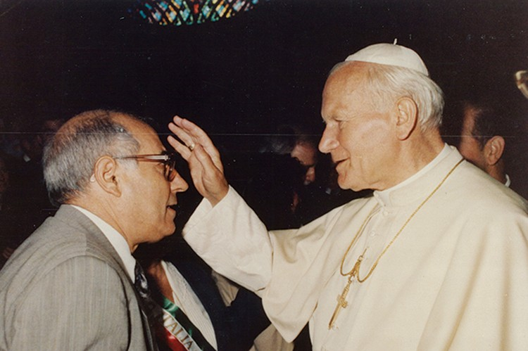 Pope John Paul II blesses Nunzio Tumino during a visit to Rome. The photo hangs in the entrepreneur's old office at Aurora Importing in Mississauga