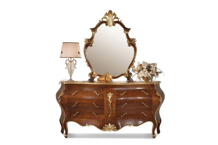 Part of a classic carved collection for the bedroom, this piece is comprised of solid cherry wood and features hand-carved details with gold- and silver-leaf accents