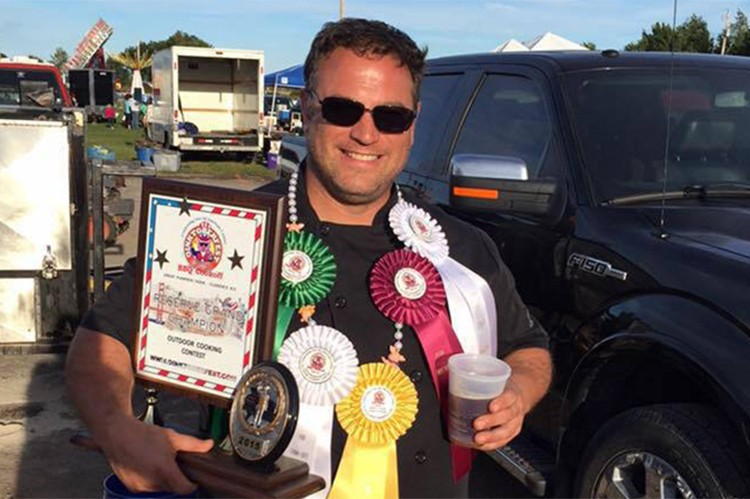 An array of ribbons declare Perrin the winner of multiple categories like brisket and ribs at Oinktoberfest's outdoor grilling contest