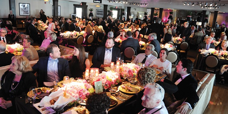 Attendees gather at Palais Royale for the Nanny Angel Network's fundraiser and dinner, which included entertainment by musician Michael Feinstein
