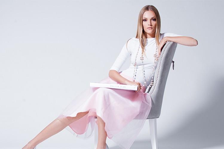 Don't forget the sparkle. Add longer necklaces to balance your outfit. Bodysuit: Holt; skirt: Mod-Est; shoes: Bebe; necklace: Chanel