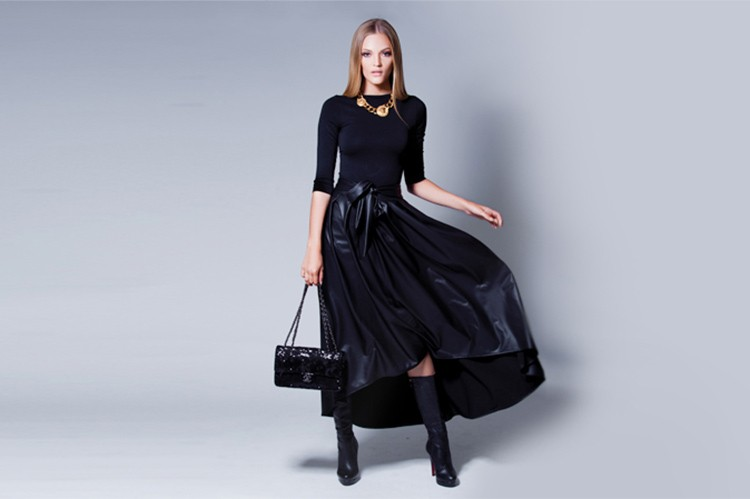 Not a fan of tutus? Try pairing an all-black, leather silhouette with gold details. Bodysuit: Holt; skirt: Mod-Est; necklace: Versace; boots: Christian Louboutin; bag: Chanel