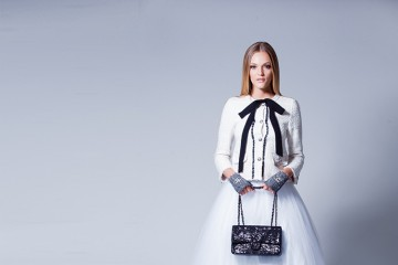 Have fun with your look. Match darker, edgier accessories with whimsical skirts. Jacket, gloves and bag: Chanel; skirt: Mod-Est