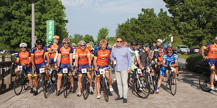 Mayor Maurizio Bevilacqua stands beside Team Revolution at the starting line