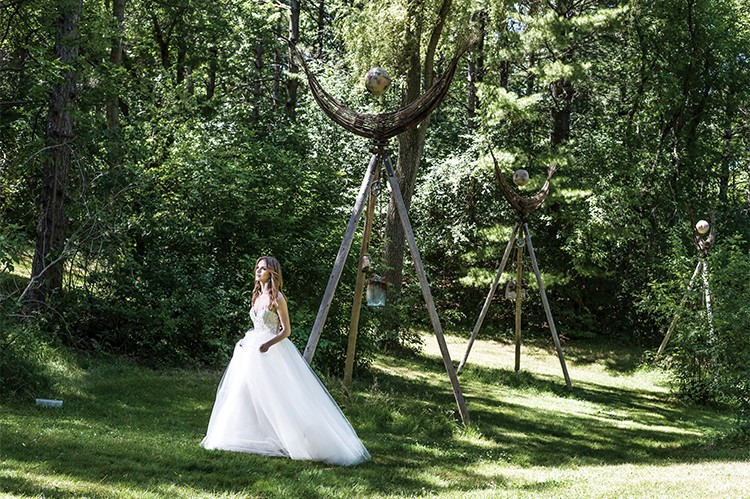 """1. With an illusion neckline and hand-beaded embroidery, this fairy tale tulle gown evokes starry nights and enchanting moonlit strolls   """"Style 6828"""" by Liancarlo,  Mona Lisa Bridal Gallery,  monalisabridalgallery.com Earrings by Rita Tesolin,  ritatesolin.com"""