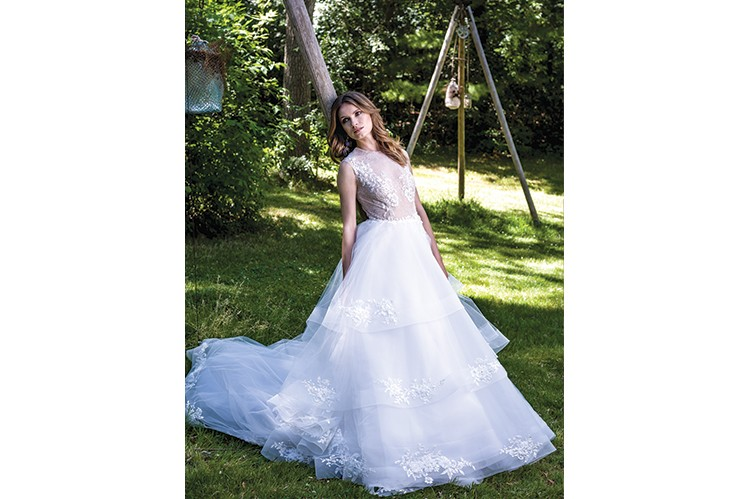 """2. A cascade of lush, white layers and delicately embroidered florals make this gown an ode to a foliage-dotted stream    """"Luscent"""" by Ines Di Santo,  inesdisanto.com Earrings by Rita Tesolin,  ritatesolin.com"""