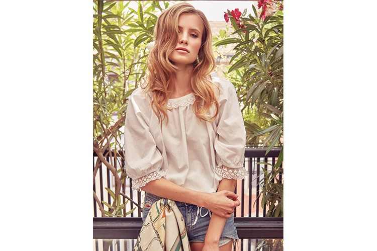 2. If you're looking to show off your glow, try out a pair of jean shorts. Paired with white, your look will give off a classic beach vibe