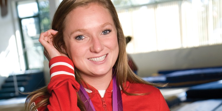 Local trampolinist Rosie MacLennan shines with her Olympic gold medal around her neck.