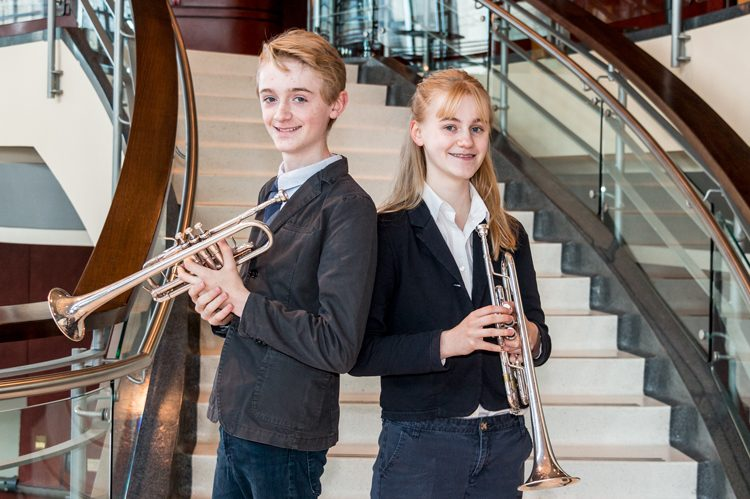 The duo's younger sister, Maslin, also plays the trumpet and they often perform as a trio