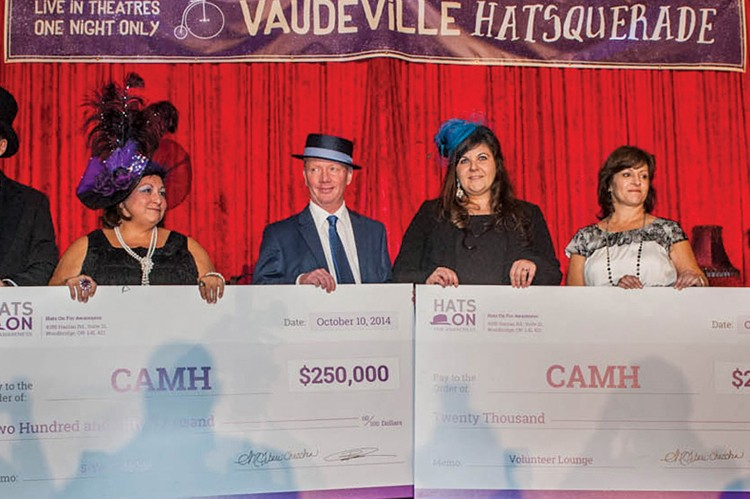Benny Caringi and Enza Tiberi-Checchia, cofounders of Hats On For Awareness, present two cheques totaling $270,000 to CAMH delegates