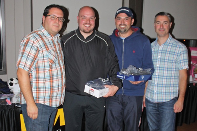 Event organizers Aurelio Calabretta and Claudio Chiappetta (left and right) with tournament winners Nick Koinis and Greg Tsagogeorgas (middle)