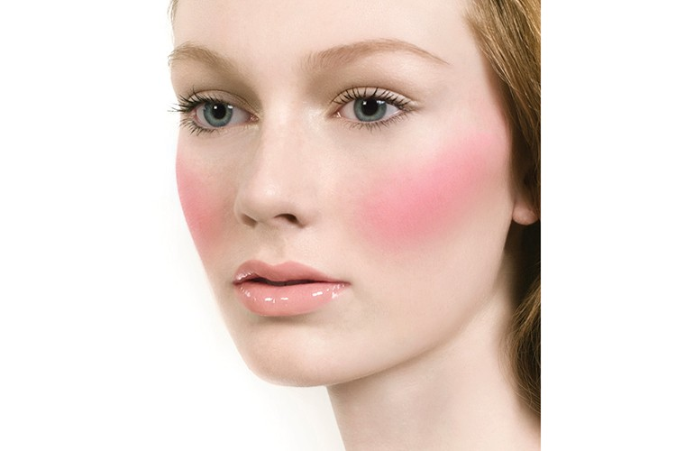 Peachy innocence is created with minimal eye makeup and an emphasis on the cheeks