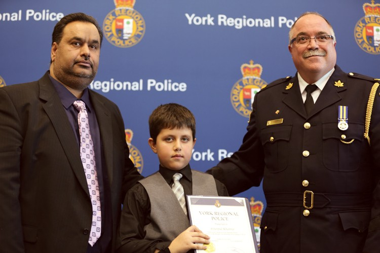 Six-year-old Arjunpal Khattra from Markham received an award of bravery for helping his father when he was trapped in a 25-foot-deep well