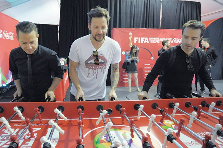 simple-plans-david-desrosiers-pierre-bouvier-and-sebastien-lefebvre-having-some-fun-at-the-foosball-table