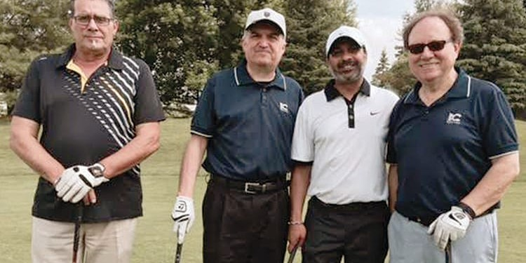 Fausto Gaudio (far right) with golfers