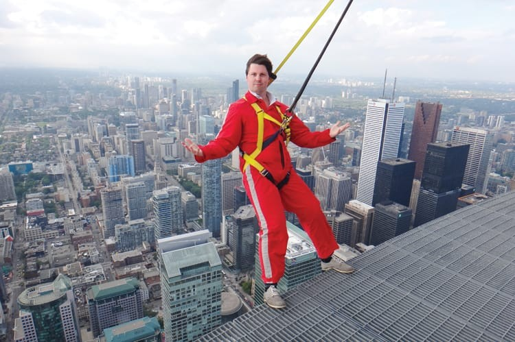 City Life's Michael Hill enjoys his time on the EdgeWalk