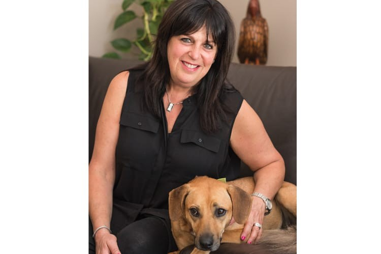 Lynda Fishman at home with Lexy, one of her three rescued dogs
