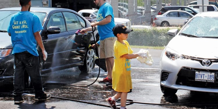 Volunteers gather at Krown's Markham location to wash cars for the cause