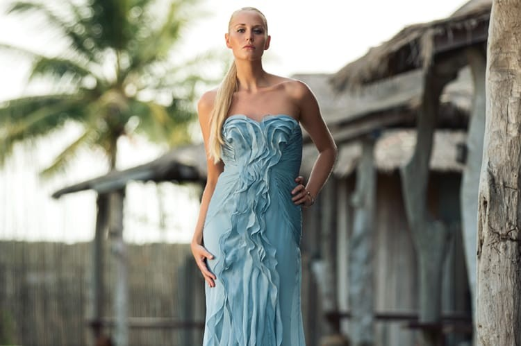The ruched panelling and cascading details of this elegant evening gown are softened by its light blue hue — a dreamy look for a candlelit dinner next to the splashing waves of the ocean www.adriannapapell.com