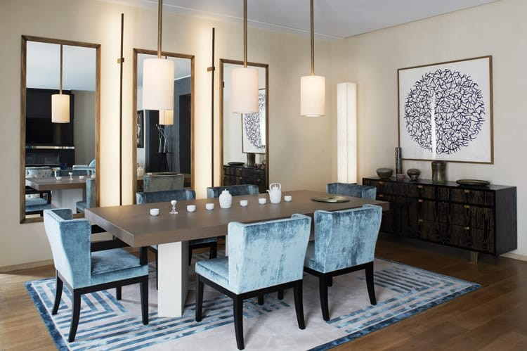 The dining area features a table, mirrors and ceiling lights designed by Coutas with a Tai Ping rug, ceramic items by Jean Girel and painting by Rico.